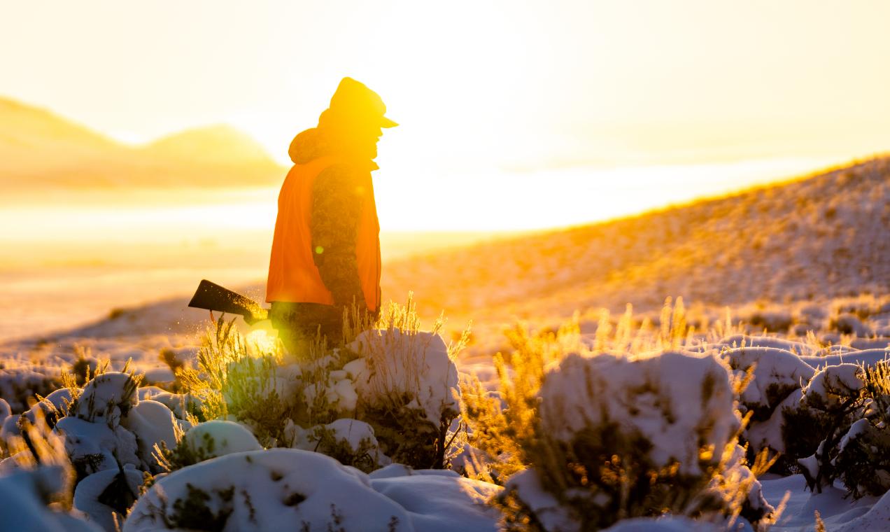 hunter walking through snow