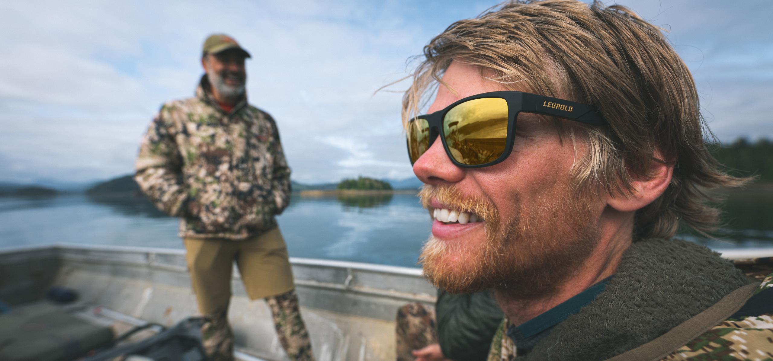 hunter wears leupold katmai eyewear on boat